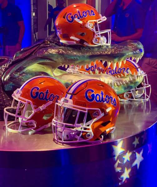 Gator football helmets and gator head inside the Swamp at the University of Florida.
